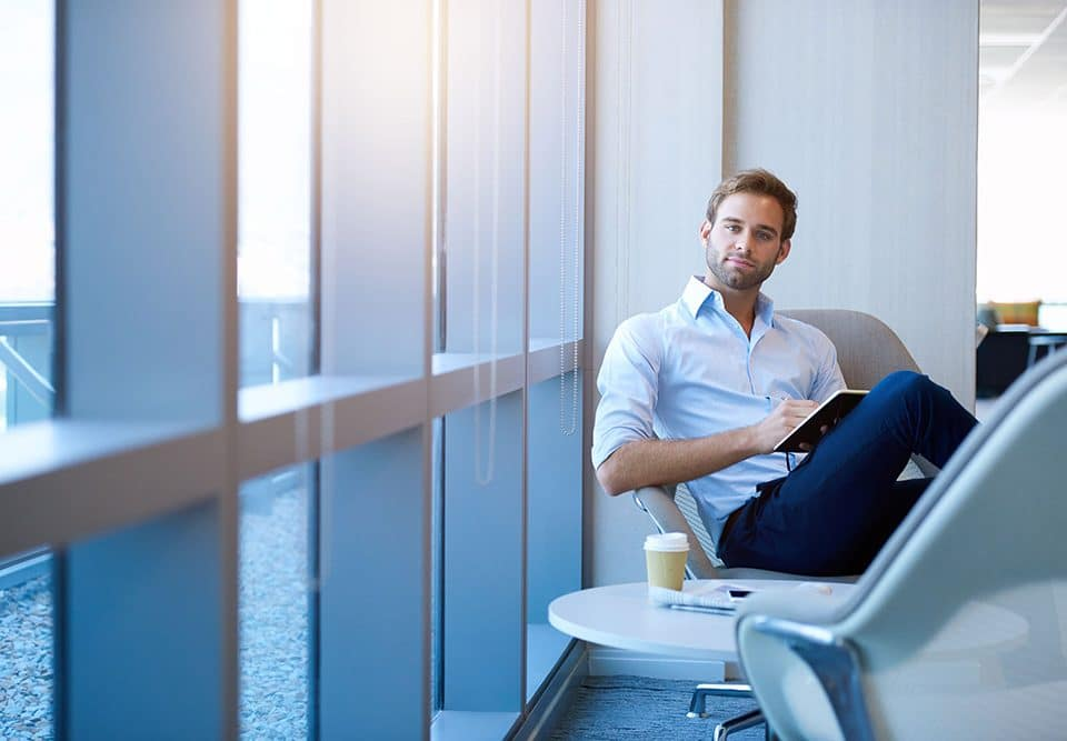 man in chair looking at affordable mortgages